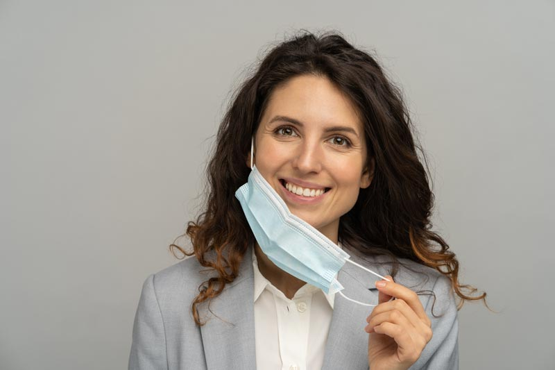 business-woman-taking-off-mask-from-face-coronavir